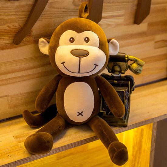 śmieszny pluszak w kształcie małpki