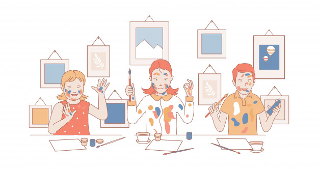 trójka dzieci maluje przy stole