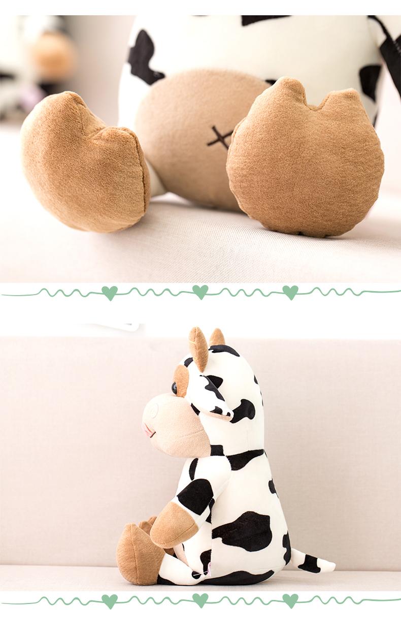 śmieszny pluszak krowa